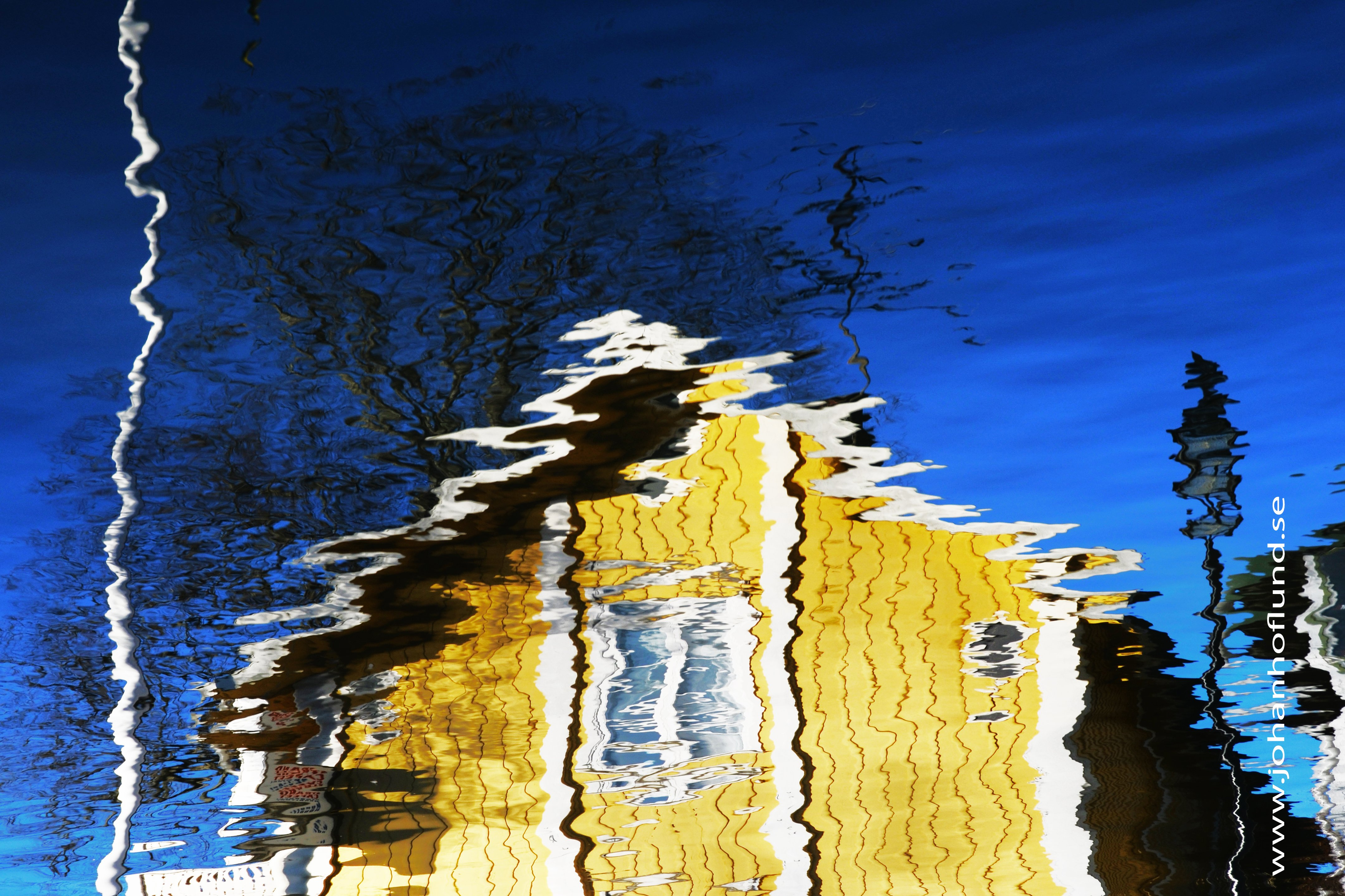 Blue sky, blue water and a yellow house